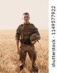 soldier man standing against a... | Shutterstock . vector #1149577922