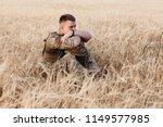 soldier man standing against a... | Shutterstock . vector #1149577985