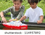 children playing with boat | Shutterstock . vector #114957892