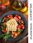 tomato salad with grilled... | Shutterstock . vector #1149587585