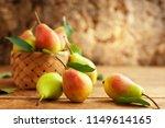 fresh ripe pears in basket on... | Shutterstock . vector #1149614165