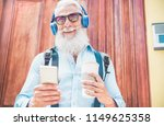 happy senior man going out from ... | Shutterstock . vector #1149625358