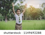 kid scout raise two arms. happy ... | Shutterstock . vector #1149692288
