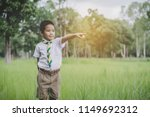 kid scout stand and finger... | Shutterstock . vector #1149692312