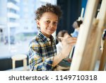 happy mixed race pupil looking... | Shutterstock . vector #1149710318