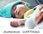 asian toddler boy get sick he... | Shutterstock . vector #1149754262