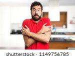 handsome man freezing inside... | Shutterstock . vector #1149756785