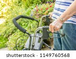 aging woman's on hand holding... | Shutterstock . vector #1149760568