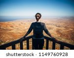 woman looking at volcanic... | Shutterstock . vector #1149760928