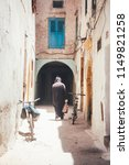 moroccan man from the back... | Shutterstock . vector #1149821258