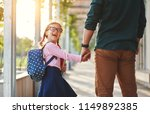 first day at school. father... | Shutterstock . vector #1149892385