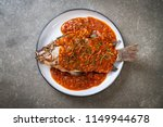 deep fried fish with chili sauce | Shutterstock . vector #1149944678