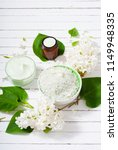 cosmetic creams and white lilac ... | Shutterstock . vector #1149948335