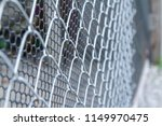 chain link fencing close up | Shutterstock . vector #1149970475