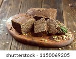 baked bread on wooden table... | Shutterstock . vector #1150069205