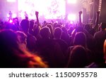 cheering crowd with raised... | Shutterstock . vector #1150095578