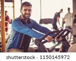 smiling sports man in gym... | Shutterstock . vector #1150145972