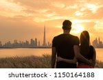 two lovers looking at the city... | Shutterstock . vector #1150164188