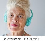 portrait of smiling elderly... | Shutterstock . vector #1150174412