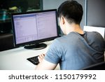a male programmer is coding on... | Shutterstock . vector #1150179992