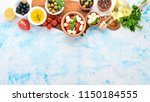 cooking a caprese salad.... | Shutterstock . vector #1150184555