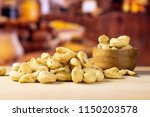 lot of whole raw cashew nut... | Shutterstock . vector #1150203578
