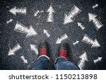 sneakers on the asphalt road... | Shutterstock . vector #1150213898