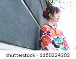 young asian girl wearing kimono ... | Shutterstock . vector #1150224302