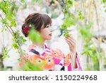 young asian girl wearing kimono ... | Shutterstock . vector #1150224968