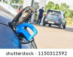 electric car charging.... | Shutterstock . vector #1150312592