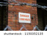 danger 11 000 volts sign on...