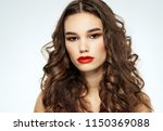 woman with red lips and wavy... | Shutterstock . vector #1150369088