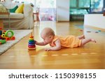 baby girl playing with stacking ... | Shutterstock . vector #1150398155