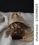 homemade rye bread wrapped in... | Shutterstock . vector #1150398425