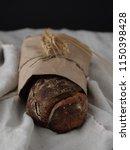 homemade rye bread wrapped in... | Shutterstock . vector #1150398428