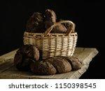 homemade rye bread in a basket... | Shutterstock . vector #1150398545