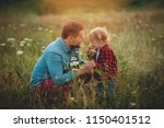 happy family. father and little ... | Shutterstock . vector #1150401512