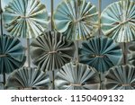 abstract folded fabric pattern... | Shutterstock . vector #1150409132