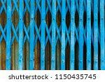 old steel folding sliding door  ... | Shutterstock . vector #1150435745