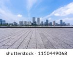 empty square with city skyline... | Shutterstock . vector #1150449068