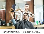 confident handsome customer... | Shutterstock . vector #1150466462