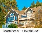 a perfect neighborhood. houses... | Shutterstock . vector #1150501355