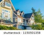 a perfect neighborhood. houses... | Shutterstock . vector #1150501358