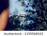 street light in a blurred... | Shutterstock . vector #1150568102