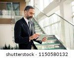 portrait of handsome senior... | Shutterstock . vector #1150580132