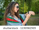 young woman watching time on...   Shutterstock . vector #1150582505