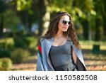 one fashion woman walk in a...   Shutterstock . vector #1150582508