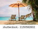 beach chairs on the tropical... | Shutterstock . vector #1150582832