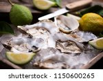 oysters on crushed ice close up  | Shutterstock . vector #1150600265
