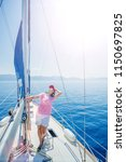 young woman relaxing on yacht... | Shutterstock . vector #1150697825